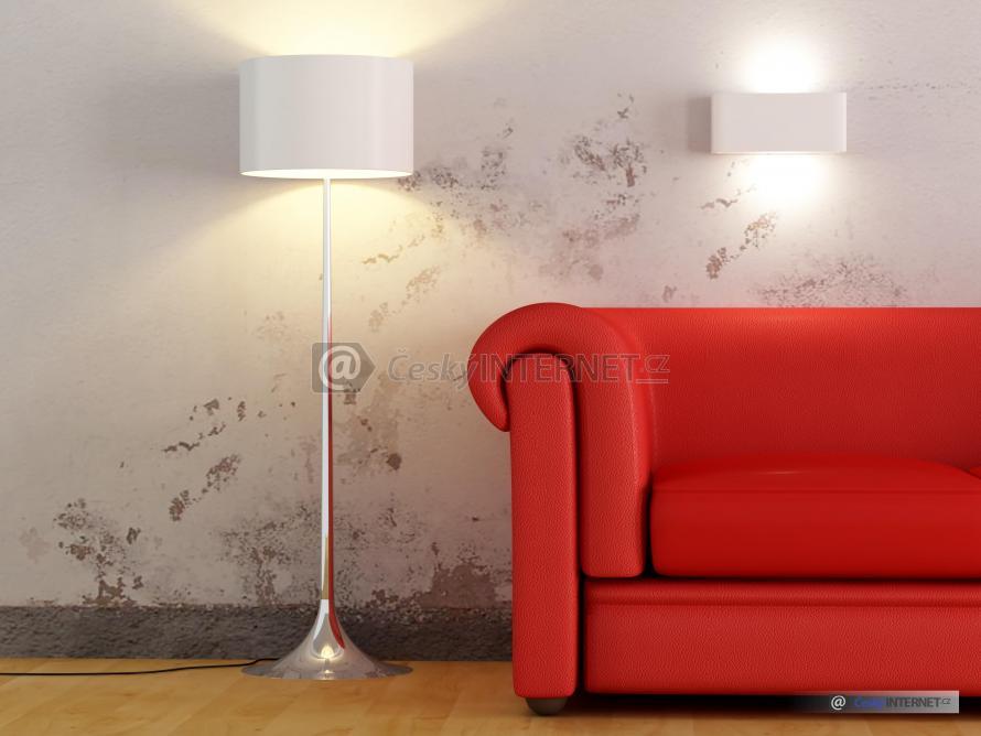 Cihlová kožená sedací souprava s polštáři a lampou - detail, osvětlení solitéru v interiéru. Atmosféra.